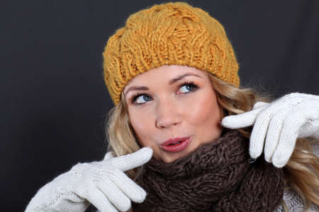 Portrait of beautiful woman wearing winter accessories photo