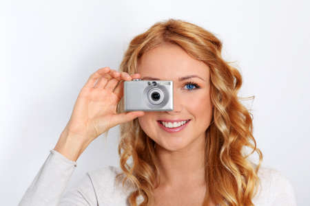 Portrait of beautiful blond woman taking picture Stock Photo - 11616355