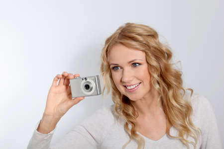 Portrait of beautiful blond woman taking picture Stock Photo - 11616357