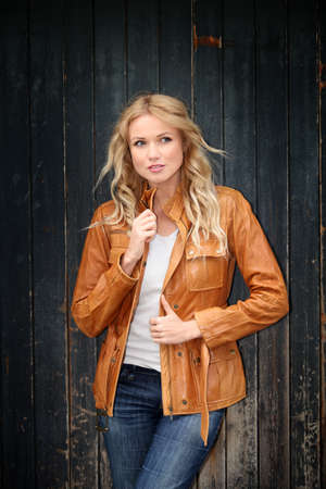 leather jacket: Portrait of beautiful blond woman with leather jacket