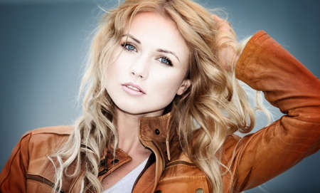 blonde  blue eyes: Portrait of beautiful blond woman with leather jacket