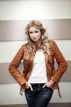 Portrait of beautiful blond woman with leather jacket Stock Photo - 11800673