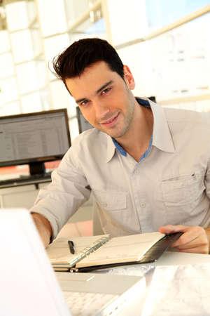 the varsity: Young man studying at university