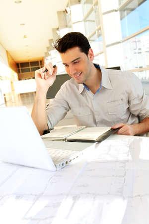 students computer: Young man studying at university