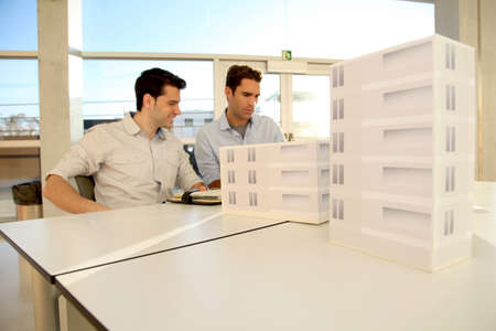 architecture model: Young architects working on project Stock Photo