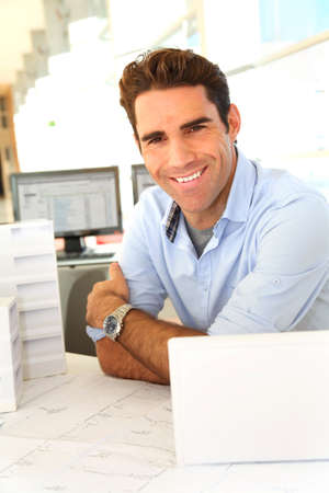 Smiling architect sitting in office Stock Photo - 11852329