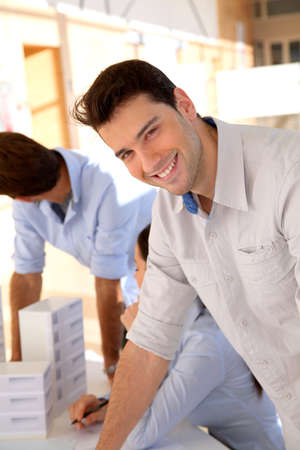 workteam: Young smiling and cheerful businessman
