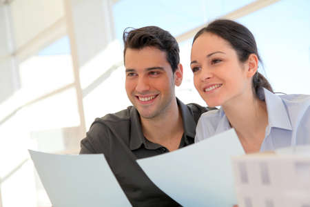 Happy young couple signing property purchase contract Stock Photo - 11852032