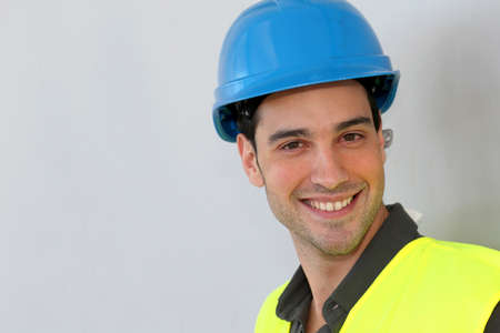 Construction trainee with security helmet photo
