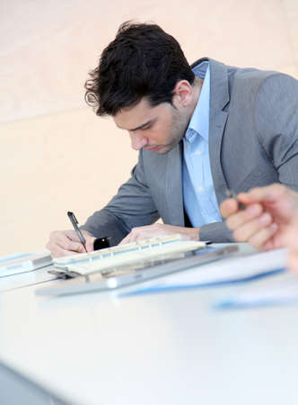 filling in: Young man filling in application form Stock Photo