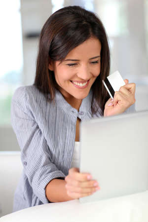 home shopping: Young woman doing online shopping with tablet