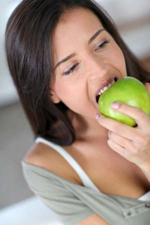 Portrait of woman eating an apple photo