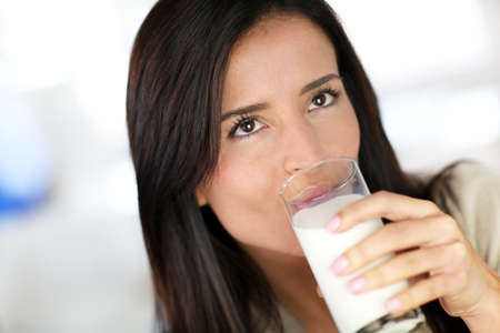 woman drinking milk: Attractive young woman drinking fresh milk