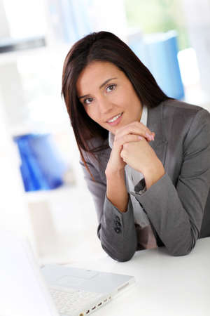adviser: Businesswoman sitting in front of laptop computer