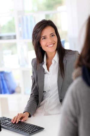 shopgirl: Beautiful garment store seller talking to customer