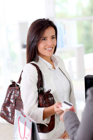 Beautiful modern woman buying with credit card Stock Photo - 12122038