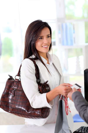 transaction: Beautiful modern woman buying with credit card