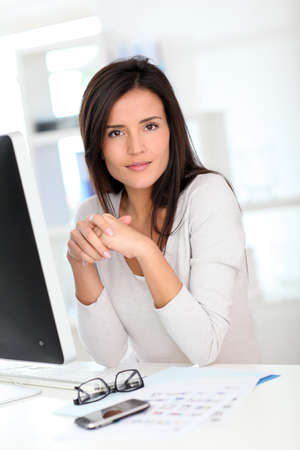 officeworker: Beautiful office worker in front of desktop computer
