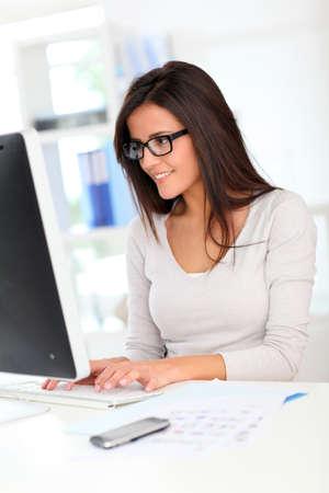 officeworker: Beautiful office worker in front of desktop computer