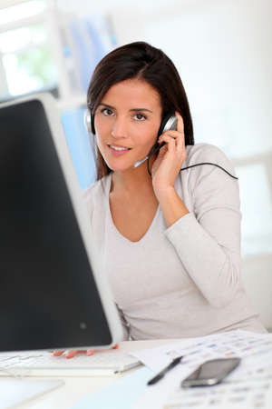 Woman in office having a video conference with business partners Stock Photo - 12121945