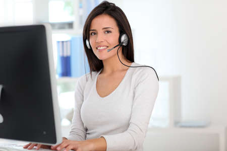 web conference: Woman in office having a video conference with business partners Stock Photo