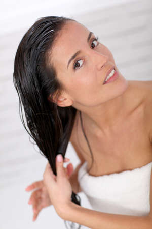 hair conditioner: Beautiful woman applying hair conditioner