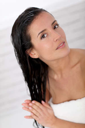 woman washing hair: Beautiful woman applying hair conditioner