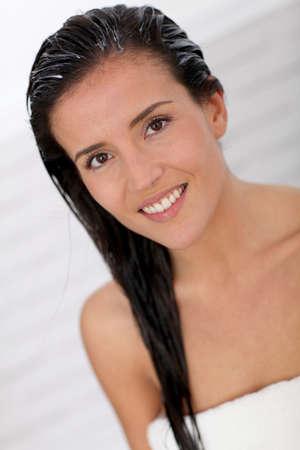 hair treatment: Beautiful woman applying hair conditioner