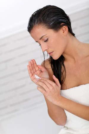 long hairs: Beautiful woman applying hair conditioner