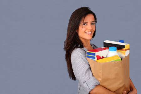 Young woman carrying bag of grocery Stock Photo - 12122396