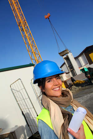 Portrait of smiling architect on building site photo
