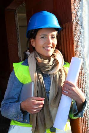 btp: Woman architect standing on construction site