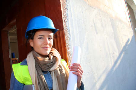 Woman architect standing on construction site Stock Photo - 12122401