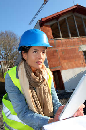 btp: Architect on building site using electronic tablet