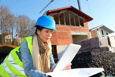 Architect on building site using electronic tablet Stock Photo - 12122403