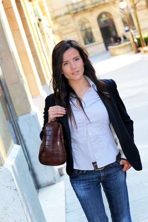 Young woman walking in town photo