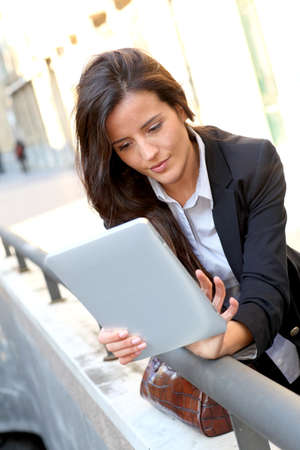 Young woman connected on internet in town photo