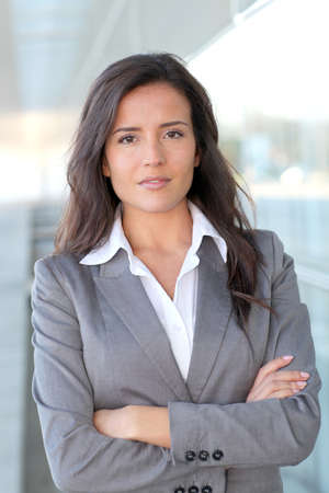 Portrait of beautiful businesswoman standing outside photo