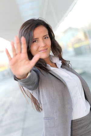 Businesswoman showing hand towards camera photo