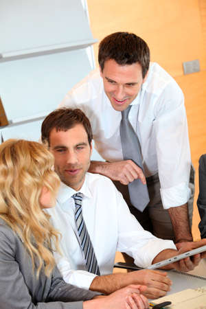 Group of business people meeting around table Stock Photo - 12557074