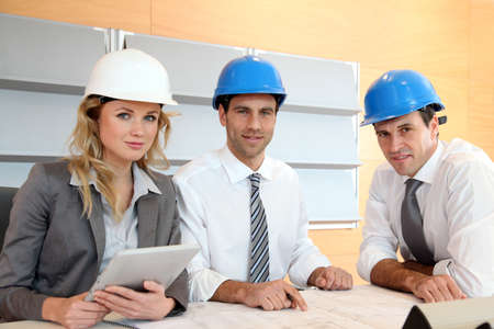 Architects and businesswomen working on construction project Stock Photo - 12557075