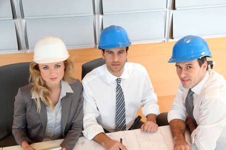 Architects and businesswomen working on construction project photo