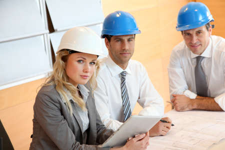 Architects and businesswomen working on construction project Stock Photo - 12557105