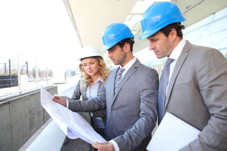 Construction engineers checking building site Stock Photo - 12557056