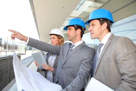 helmet construction: Construction engineers checking building site