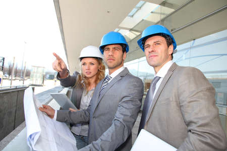 Construction engineers checking building site Stock Photo - 12557137