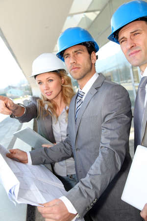 Construction engineers checking building site Stock Photo - 12557059