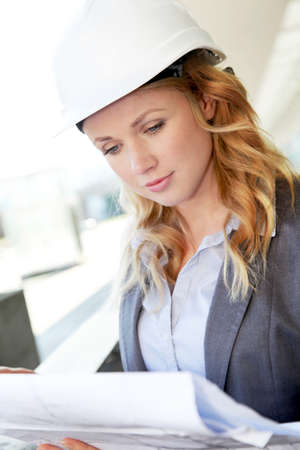Portrait of beautiful woman architect looking at plan Stock Photo - 12556646