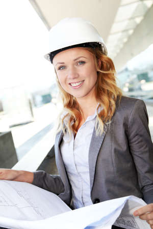 Portrait of beautiful woman architect looking at plan Stock Photo - 12557142