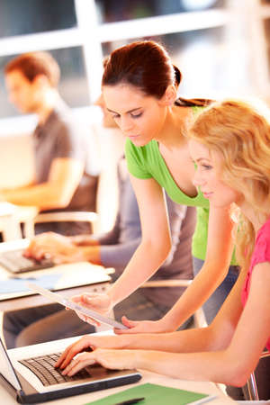 Colleagues in office working with tablet Stock Photo - 12557126